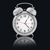 Chrome Alarm-Clock on black background with Royalty Free Stock Images