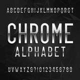 Chrome alphabet font. Metallic effect letters and numbers on a dark polygonal background. Royalty Free Stock Image