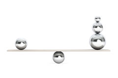 Chrome Balancing Balls over Wooden Board Royalty Free Stock Photography