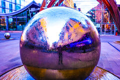Chrome Ball. Dynamic image of a sculpture in the centre of Sheffield Royalty Free Stock Photo