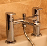 Chrome bathtub faucet Stock Photo