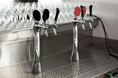 Chrome beer taps at the bar Stock Photography