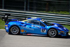 Chrome Blue Ferrari 488 Challenge in action. Rossocorsa team brings his brand new Ferrari 488 Challenge on track at the Monza Circuit Stock Image