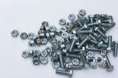 Chrome bolts and nuts closeup on a white background royalty free stock photos
