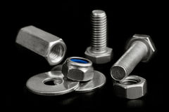 Chrome Bolts and Nuts isolated on black Stock Photo
