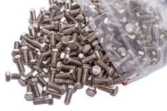 Chrome bolts in a plastic bag Stock Photos