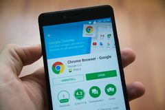 Chrome Browser application in google play store. Los Angeles, november 2, 2017: Man hand holding smartphone with Chrome Browser application in google play store Stock Images