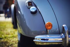 The chrome bumper of the antique car. The chrome bumper of the antique car is beautiful purple lilac with a turn indicator Royalty Free Stock Photography