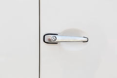Chrome car door handle on white car Royalty Free Stock Photography