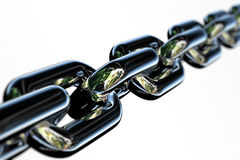 Chrome Chain. Closeup of a few links of a chrome chain with very shallow depth of field Royalty Free Stock Photo