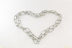 Chrome chain forming heart. On white Royalty Free Stock Photography