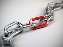 Chrome chain. With a red link Royalty Free Stock Photography