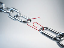 Chrome chain with a red link clip Royalty Free Stock Photos