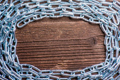 Chrome chain on wooden background Stock Photo