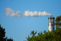 Chrome chimney. A smoking industry chimney in berlin / germany royalty free stock images