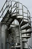 Chrome Circular Stairway & Wine Fermentation Tanks Stock Photography