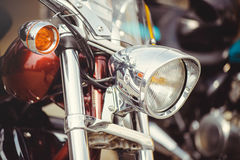 Chrome classic motorcycle headlight. And turn signals, soft toning of a warm color for the calendar Royalty Free Stock Image