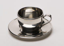Chrome coffee cup. On white backgrouind royalty free stock photos