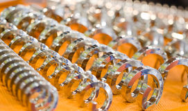 Chrome Coil Spring. S Spiral focus on Middle piece royalty free stock image
