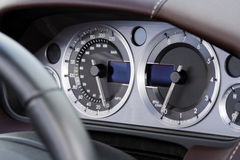Chrome dials on fast modern car Stock Photos