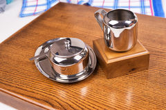 Chrome dishes on the table Royalty Free Stock Image