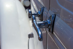 Chrome door handles on antique auto Stock Image
