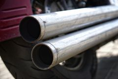 Chrome double motorcycle exhaust pipe. Problems of ecology and air pollution royalty free stock photography