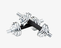 Chrome dumbbells. The exercise tool to increase your arm muscles Royalty Free Stock Photography