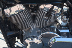 Chrome engine motorcycle road close-up Stock Image
