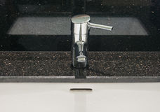 Chrome faucet. In bathroom with black marble background Stock Photos