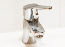 Chrome faucet with handle Royalty Free Stock Image