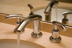 Chrome faucet in luxury bathroom Stock Photography