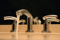 Chrome faucet in luxury bathroom Royalty Free Stock Photography