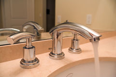 Chrome faucet in luxury bathroom Royalty Free Stock Photo