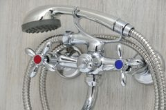 Chrome faucet with showerhead Stock Photos