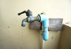 Chrome faucet and water pipeline Stock Photos