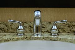 Chrome fawcett and taps Stock Photo