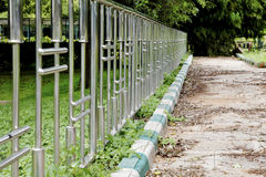 Chrome fence unswept path Gardens Bangalore Royalty Free Stock Photography