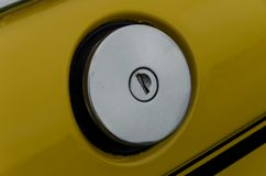Chrome filler cap. Retro chorme car petrol filler cap with key slot stock photo