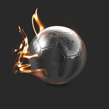 Chrome Fire Ball. A shinny and fiery reflective Silver soccer ball placed on a solid background Stock Images