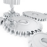 Chrome gears. Gears in chrome stacked next to each other on a white background Royalty Free Stock Image