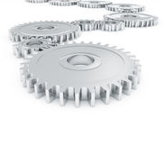 Chrome gears. Gears in chrome stacked next to each other on a white background Royalty Free Stock Photo