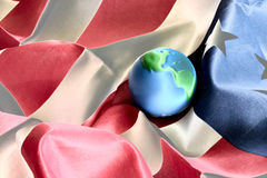 Chrome globe and American flag. Conceptual image to illustrate a global superpower, strength, business, commerce, finance, stock market, etc. Also available Royalty Free Stock Photo