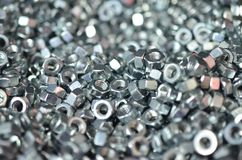 The chrome glossy nut nuts are a lot close-up. Stock Images