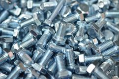 The chrome glossy nut nuts are a lot close-up. Royalty Free Stock Photos