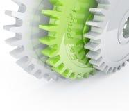 Chrome and green gears. Green gear behind chrome mechanical gears Stock Photo