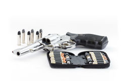 Chrome gun and bullets Royalty Free Stock Photos