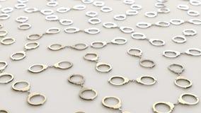 Chrome Handcuffss in een Gelijk Net op een Eenvoudige Concrete Oppervlakte Royalty-vrije Stock Afbeeldingen
