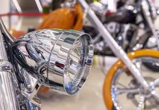 Chrome headlight on a modern sports bike royalty free stock photography