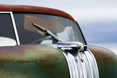 Chrome Hood Ornament. A chrome hood ornament on an abandoned, rusting car Stock Photo